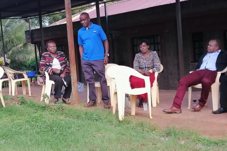 Fr. Peter Kaigwa hosts a goat eating party for the staff members