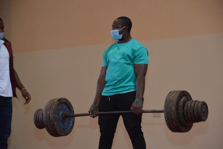 Weight lifter, dumbbells........tells it all